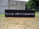 Garden sign: Youth are being imprisoned in Baltimore
