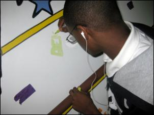 Painting a mural at the youth center